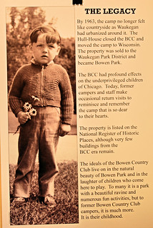 Information poster shows a young boy from the 30s in a zippered sweater and dungarees holding a small bouquet of wildflowers