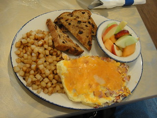 Cheese omlette, hash browns and toast