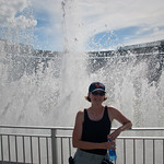 Jenn in front of fountains at Kauffman Stadium