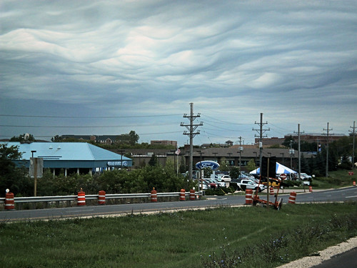 clouds over the Ford dealer