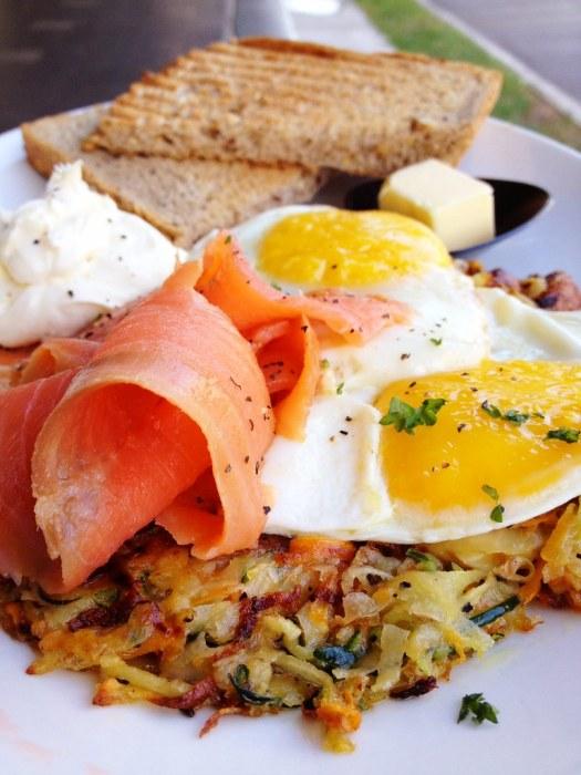 Zucchini rosti, sunny-side-up eggs, smoked salmon & lemon cream cheese