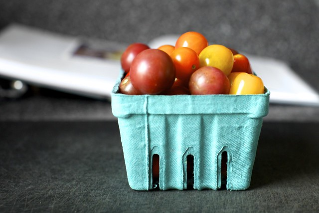 a basket of pretty tomato marbles