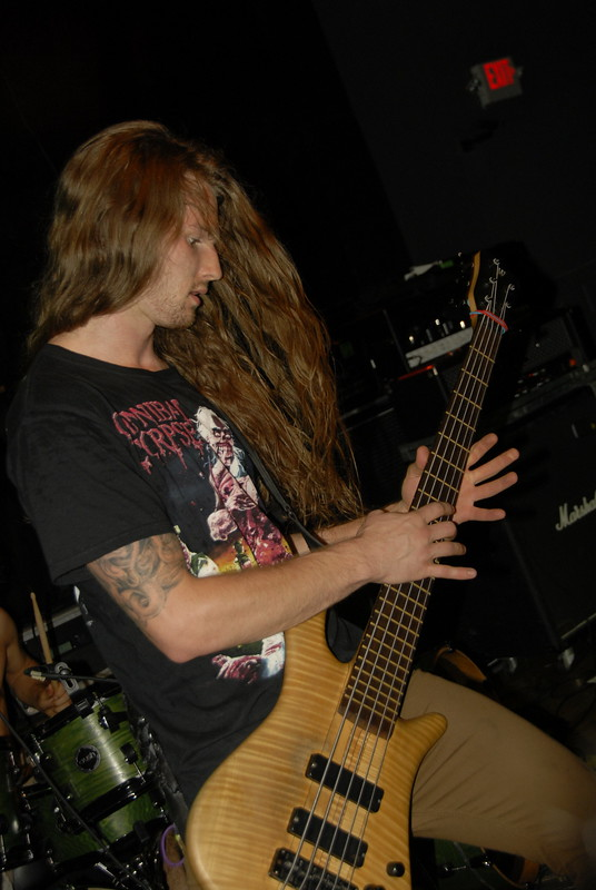 Decrepit Birth bass player