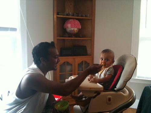 daddy feeding baby