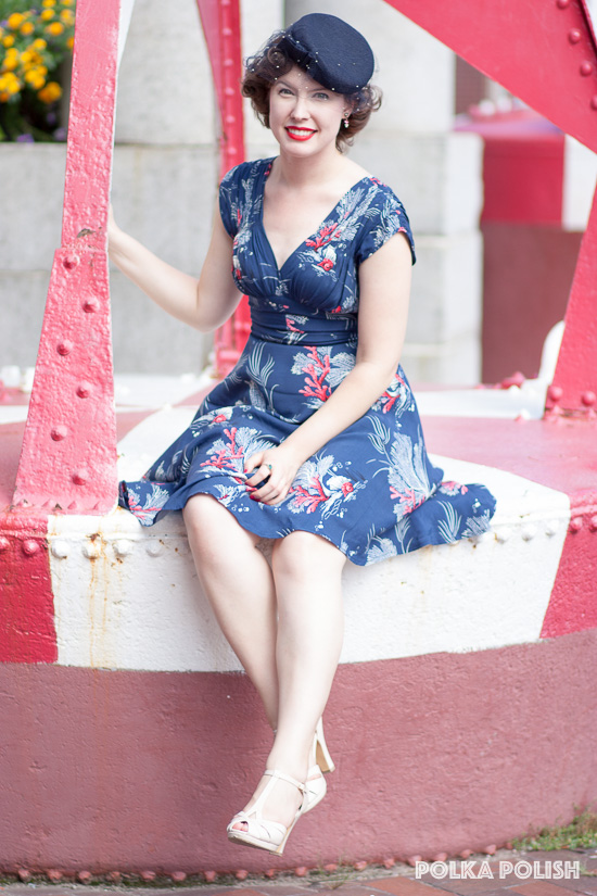 Trashy Diva Deep Sea Coral 1940s dress paired with a vintage navy tilt hat