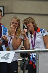 Anna Watkins and Katherine Grainger reading the banner from the Eton Dorney Gamesmakers