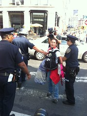 #NYPD arrests woman for holding up bra on sidewalk #BofA also @raeabileah #codepink #ows #s17