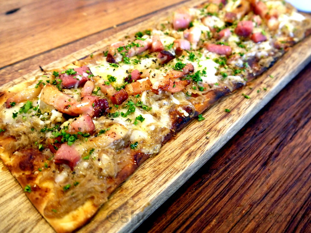 Wildflour Cafe + Bakery- tarte flambé, caramelized onions, bacon & gruyere P425