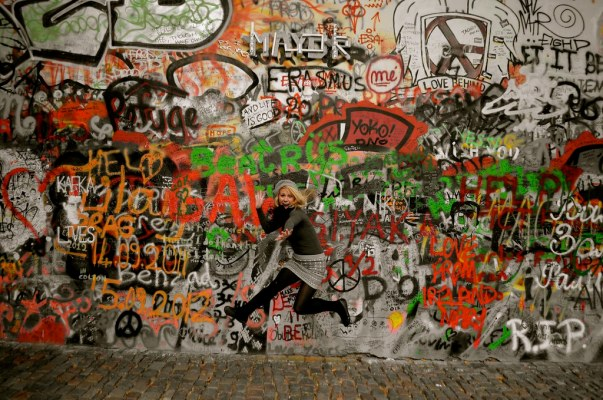 Colour Reduction: Jumping in front of John Lennon Wall in Prague