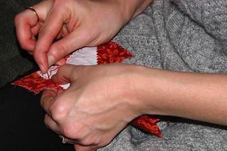 stitchin hands in orange thread