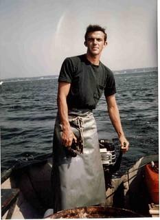 Paul lobstering in skiff 1970's