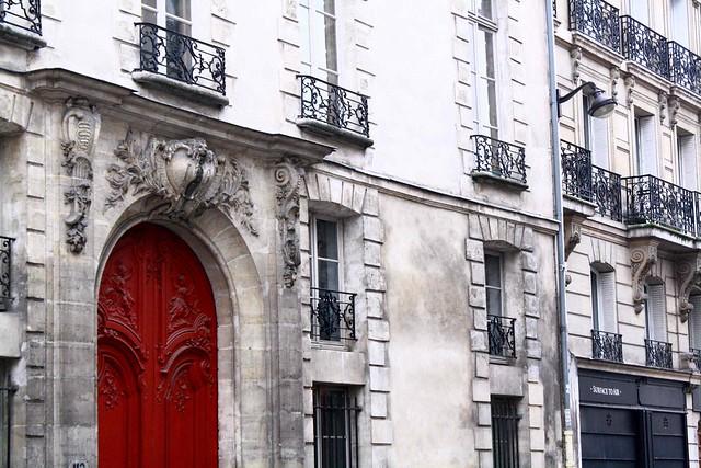 red sculpted door paris