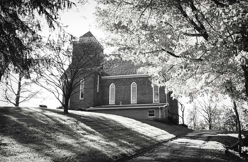 Rural church resting on the crest of a hill. Copyright Jen Baker & Liberty Images; all rights reserved.