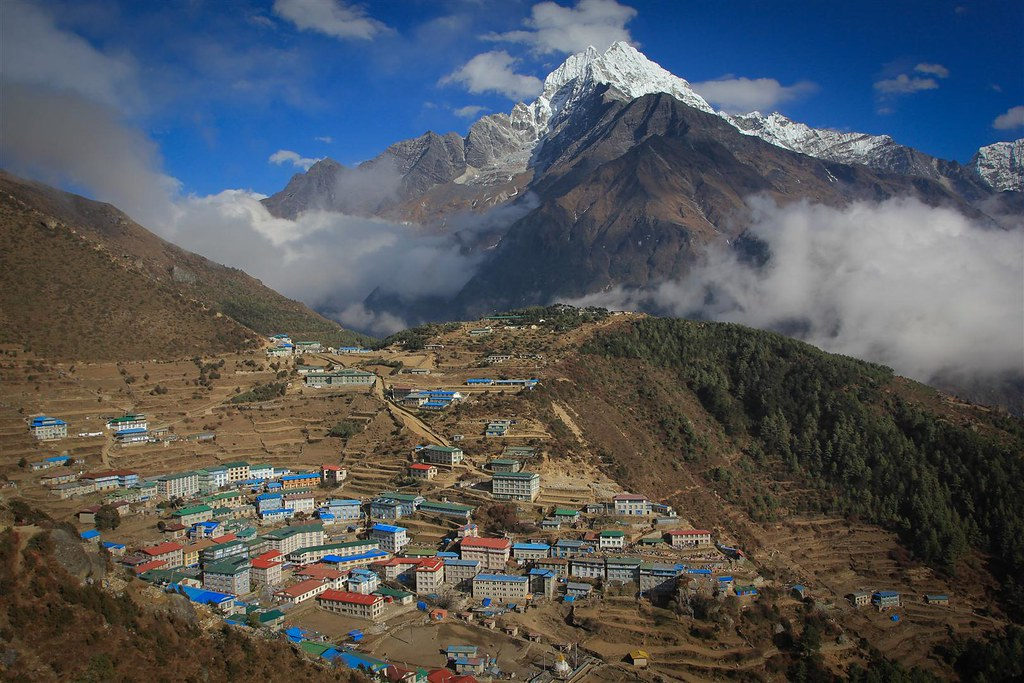 Namche Bazar (3440m), the Sherpa capital. Khumbu. Thamserku (6608m) rising sharply up the valley.