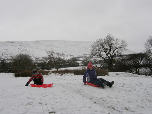 Sledging, Pendle Hill behind.