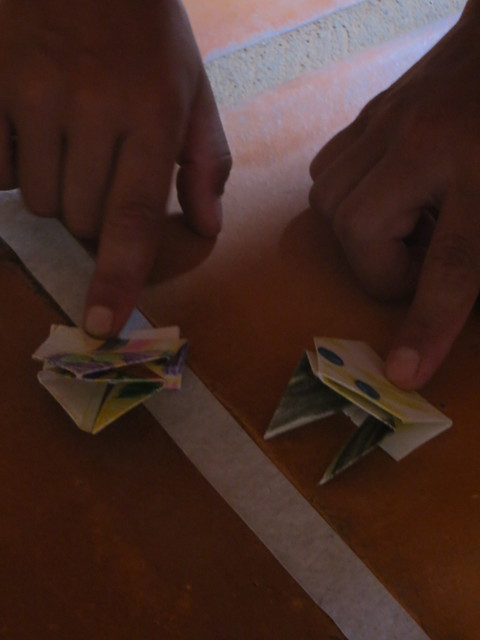 kids using origami jumping frogs
