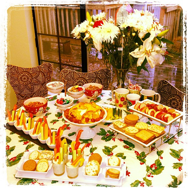 Christmas appetizers: crackers, fruit, baked Brie, veggies, and homemade ranch.