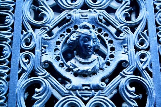 blue door carved detail paris