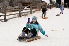 Sledding on 1830's-style sleds at Old Sturbridge Village.