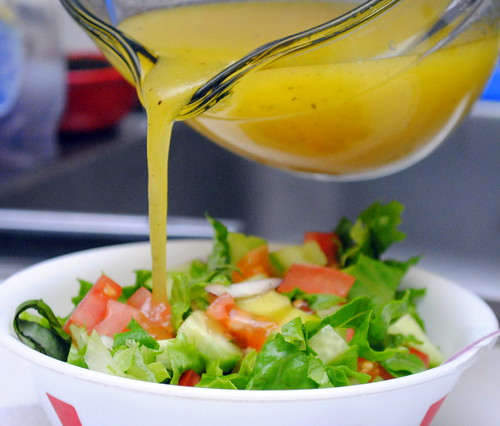 Add the dressing to the salad, toss and serve immediately.