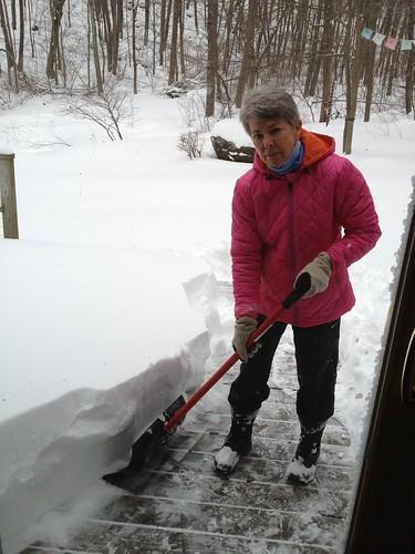 Anne shoveling the deck