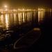 A boat tethered to a pontoon bridge