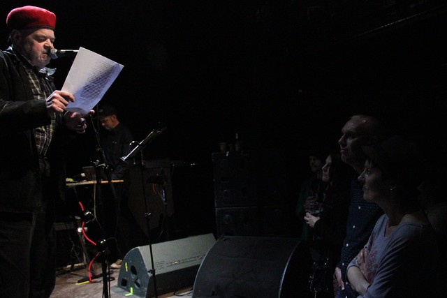 David Thomas reading to the front row at the Pere Ubu homecoming concert