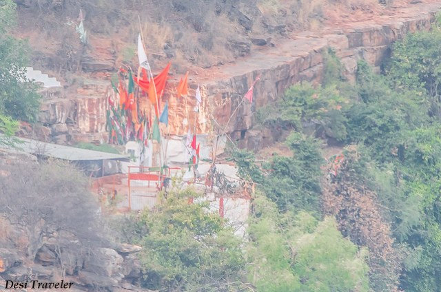 colorful flags visible on top of ranganath swamy temple Ethipothala falls