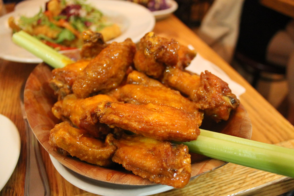 Spicy chicken wings in a basket