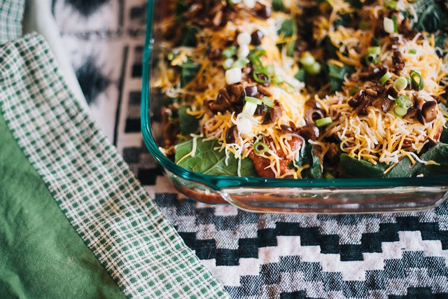 collard green spaghetti squash enchiladas with homemade red sauce