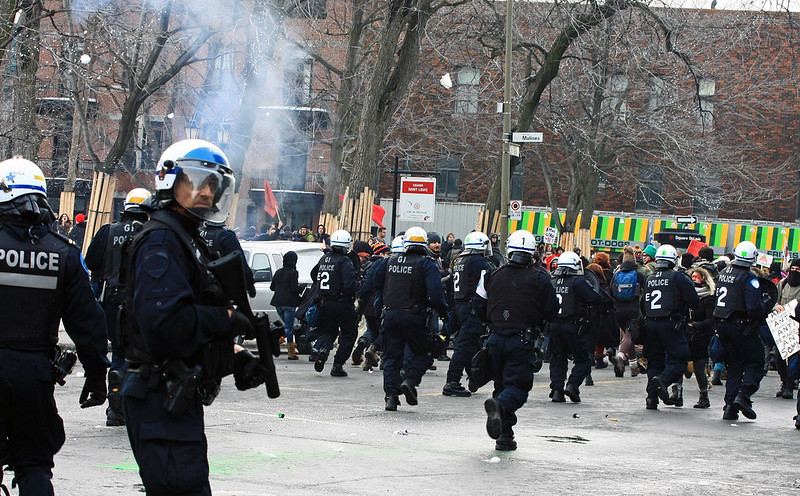 Students clash with police as summit ends