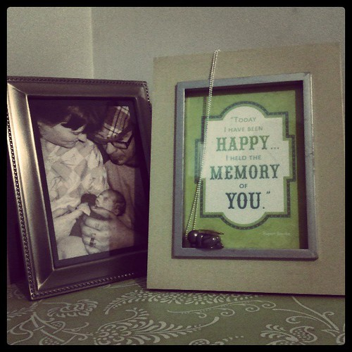I  found  a home for our little angel, bedside with our photo of Josh & I with Rex. by chauntelensey