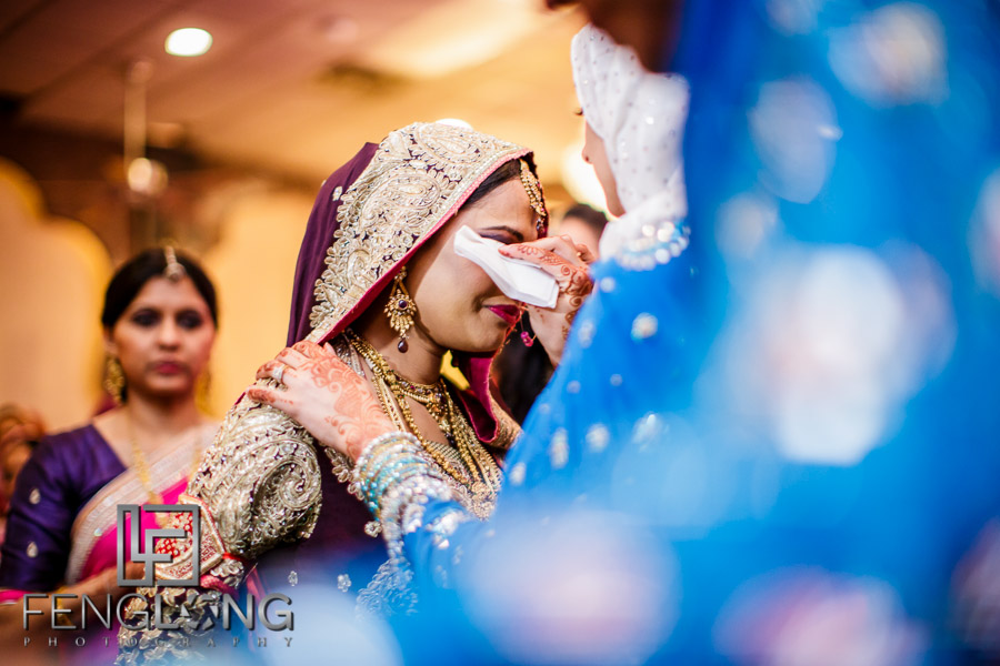 Indian bride crying during her Rukshat exit ceremony