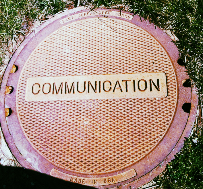 Manhole cover with the word communication