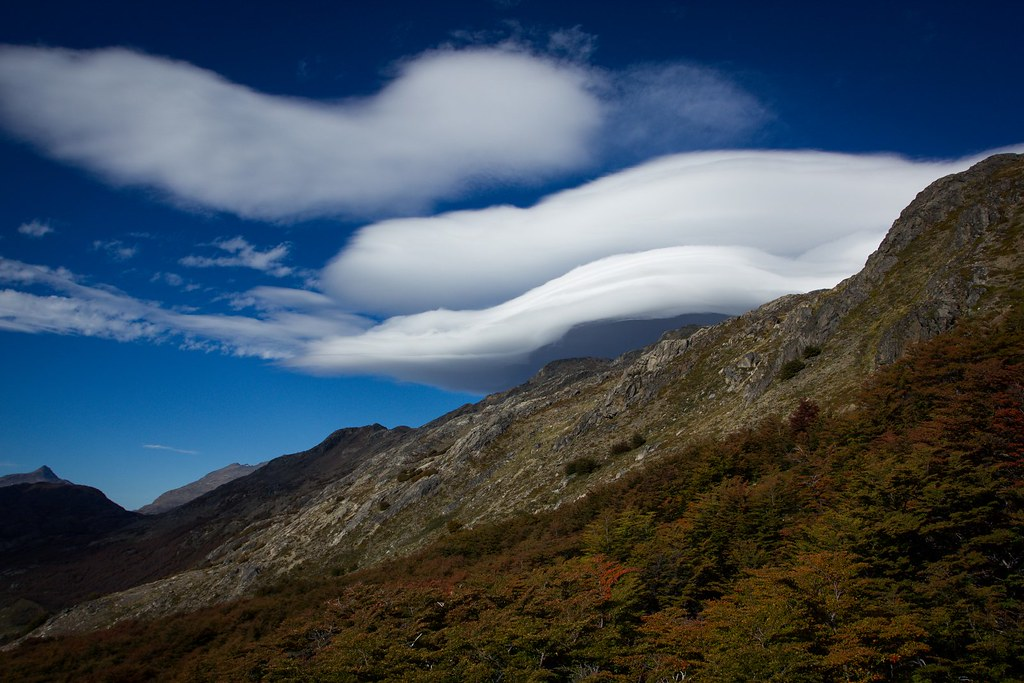 Strong winds blow of the ice cap, forming impressive lenticulars over the pass we walked over a couple hours ago. Aysen. Patagonia. Chile.