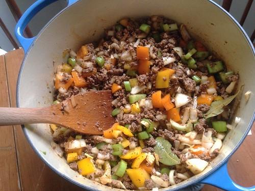 stirring in the veggies for Glenn's chili