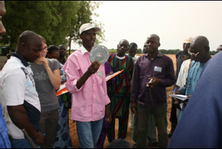 Technician showing participants the special disk (Photo credit: ICRISAT/Agathe Diama)