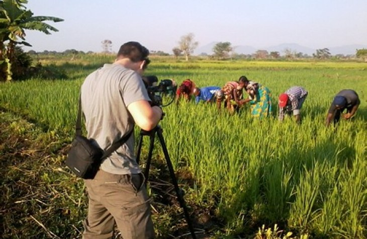 Capturing farmers hand-weeding while filming the farmer-to-farmers videos on labor-saving weed management technologies