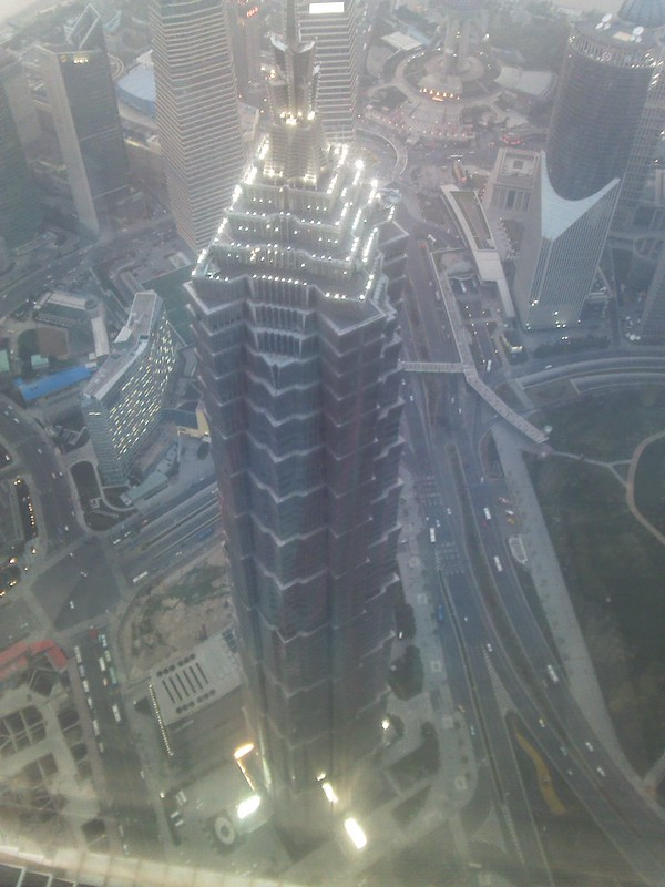 The dusk view of Jin Mao Tower seen from the 100th floor of Shanghai World Financial Center