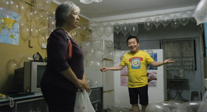 Marcus Chin's character decorates a room with inflated rubbers to surprise his wife