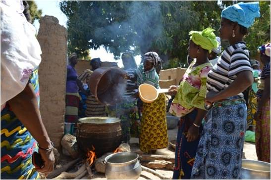 Women prepare  tamarind enriched Tô during a nutrition field  school session in N'golobougou village in Mali