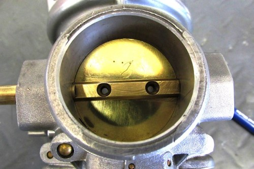 Correct Side of Throttle Plate Facing You (3 Punch Marks)
