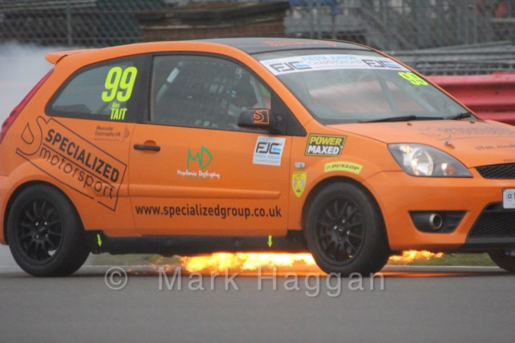 Alex Tait's car catches fire during the BRSCC Fiesta Junior Championship at Silverstone, April 2015