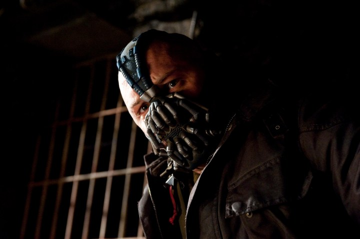 Tom Hardy as the brutally violent Bane in The Dark Knight Rises (2012). (Credit: Warner Bros Pictures)