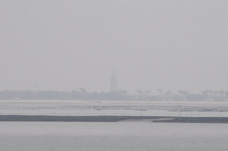 Le clocher de Marenne dans la Brume
