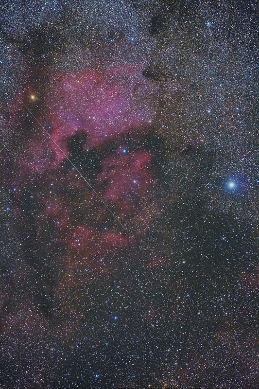a shooting star on the North America nebula