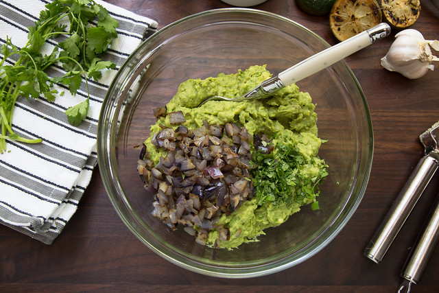 grilled guacamole in mixing bowl