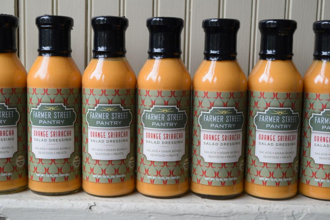 Bottles of Orange Sriracha Dressing