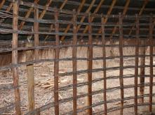 wooden structure that is filled with stones and clay