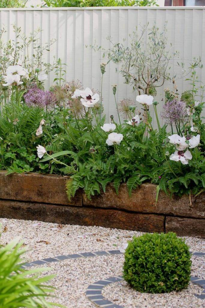 DIY Lawn Edging Ideas For Beautiful Landscaping: Railroad Tie Raised Garden Edge